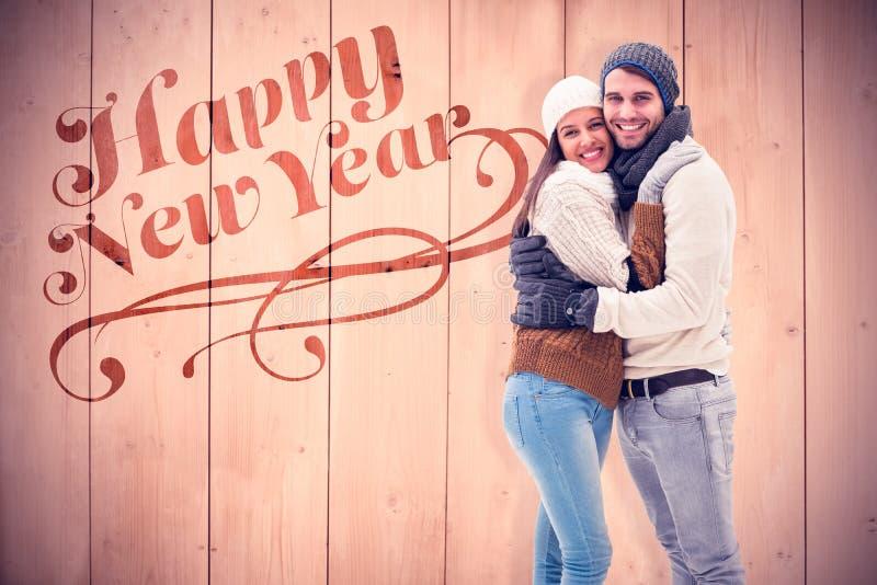 Immagine composita di giovani coppie di inverno immagini stock libere da diritti