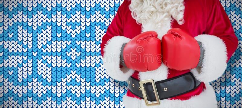 Immagine composita di metà di sezione di Santa con i guantoni da pugile immagine stock