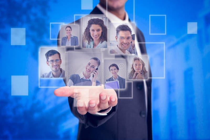 Immagine composita di presentazione dell'uomo d'affari fotografie stock libere da diritti