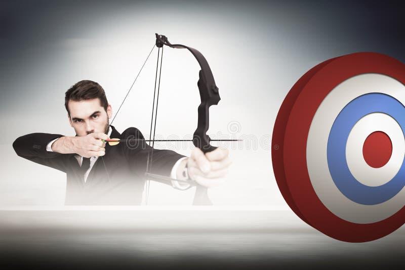 Immagine composita di tiro con l'arco di pratica dell'uomo d'affari astuto che esamina macchina fotografica fotografie stock libere da diritti