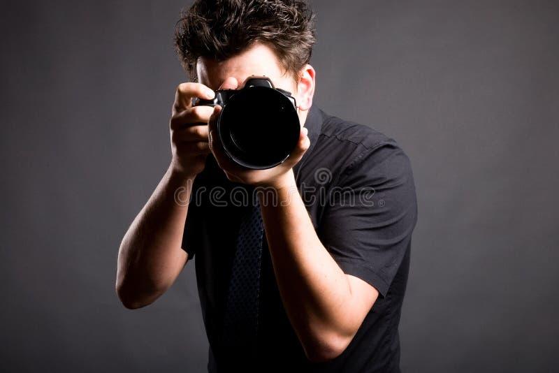 Immagine del fotografo in camicia nera fotografie stock
