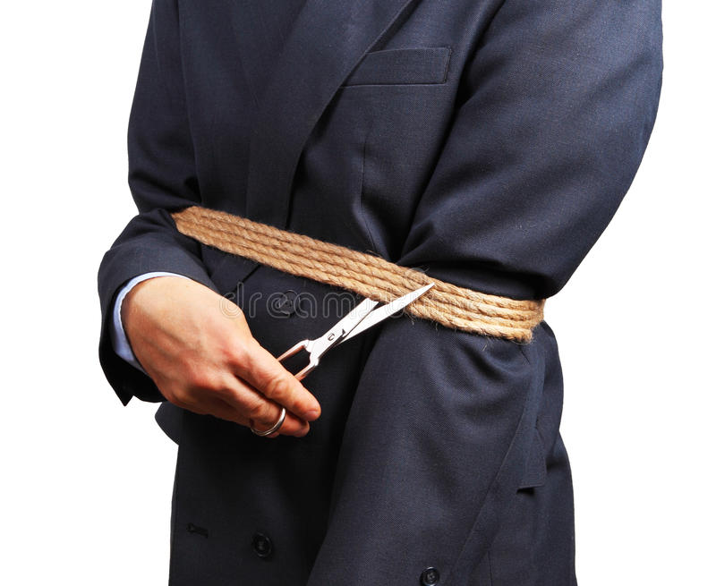 Immagine dell'uomo d'affari che prova a liberarsi dei fetters fotografia stock libera da diritti