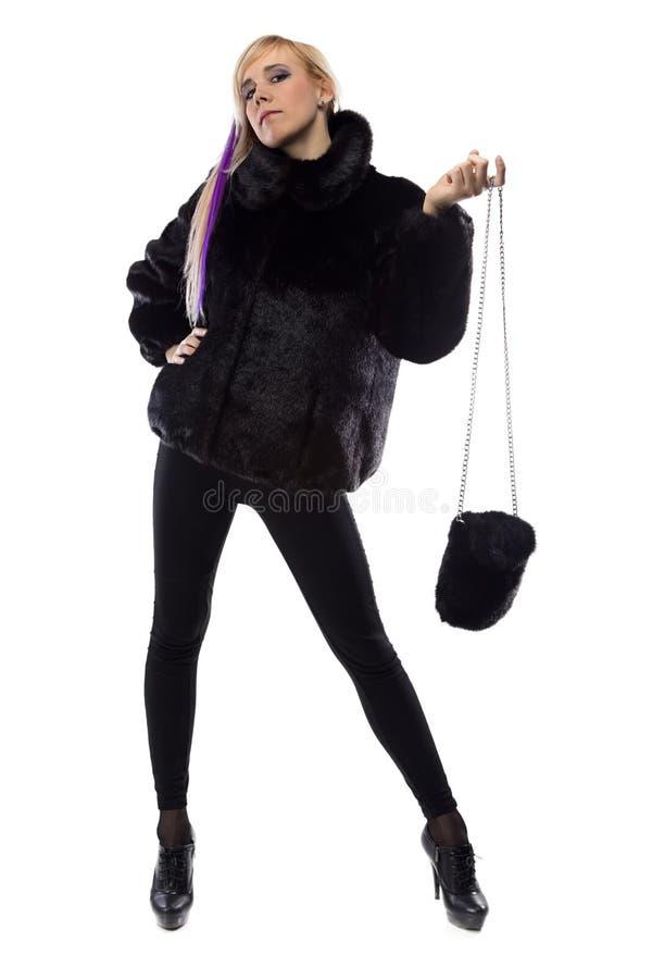 Immagine della donna con la borsa della pelliccia, mano su fotografia stock libera da diritti