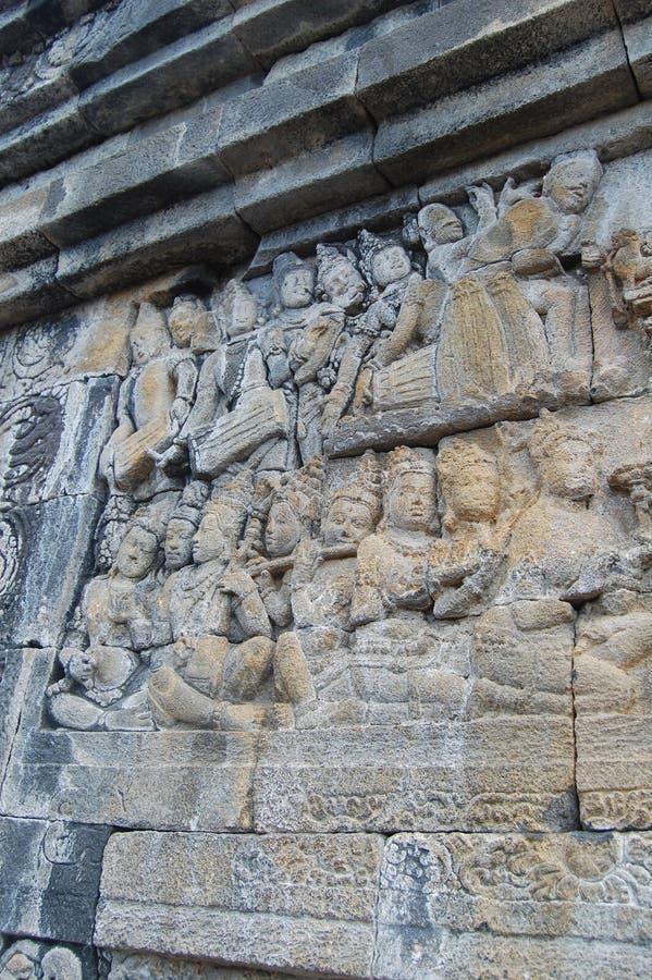 Immagine della parete di pietra scolpita, tempio di Borobudur, Java, Indonesia immagini stock