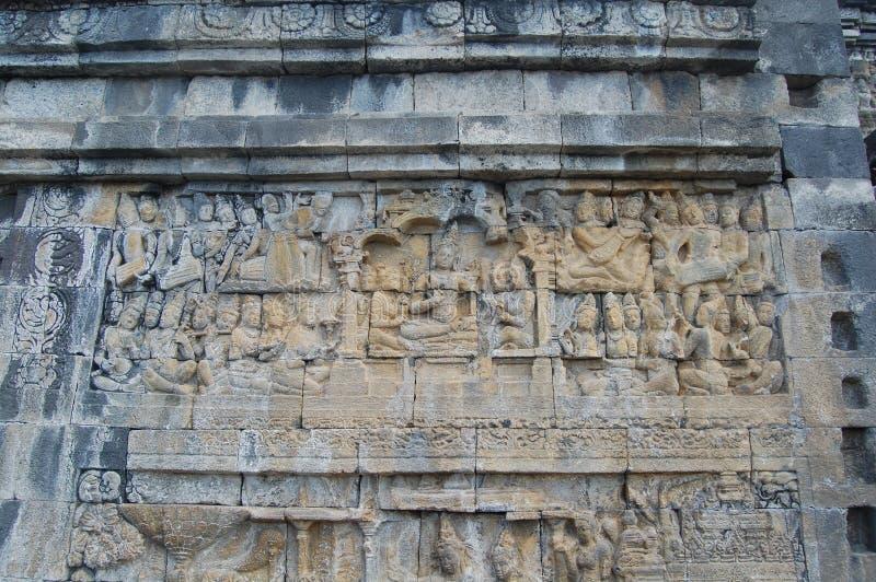 Immagine della parete di pietra scolpita, tempio di Borobudur, Java, Indonesia fotografia stock libera da diritti