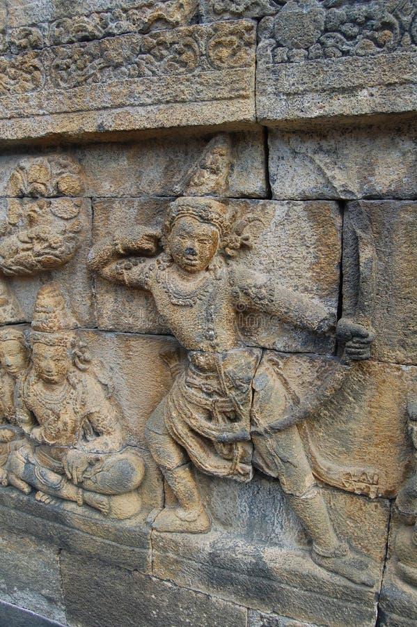 Immagine della parete di pietra scolpita, tempio di Borobudur, Java, Indonesia fotografia stock