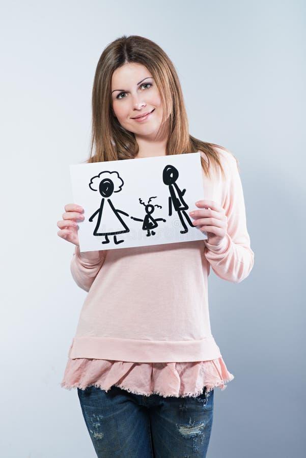 Immagine della tenuta della donna con la famiglia felice immagini stock