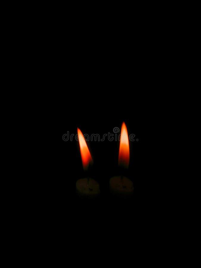 Immagine delle azione di fotografia del ritratto di scarsa visibilità della luce della candela immagini stock