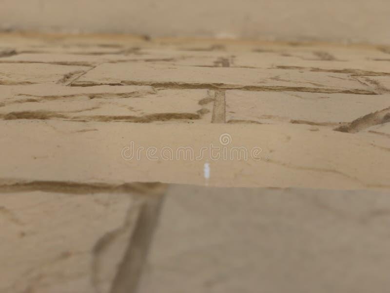 Immagine di alta risoluzione di struttura del muro di mattoni presa da un angolo unico fotografia stock