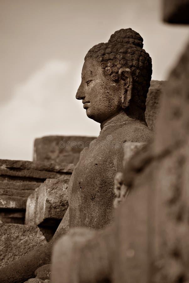 Immagine di seduta del Buddha in tempio di Borobudur, Jogjakarta, Indonesia fotografie stock libere da diritti