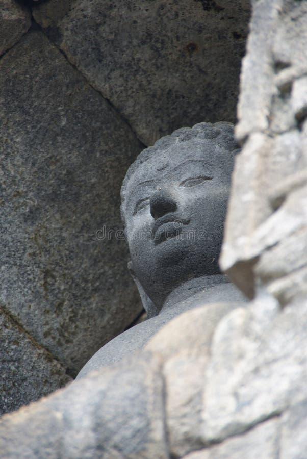 Immagine di seduta del Buddha in tempio di Borobudur, Jogjakarta, Indonesia fotografie stock
