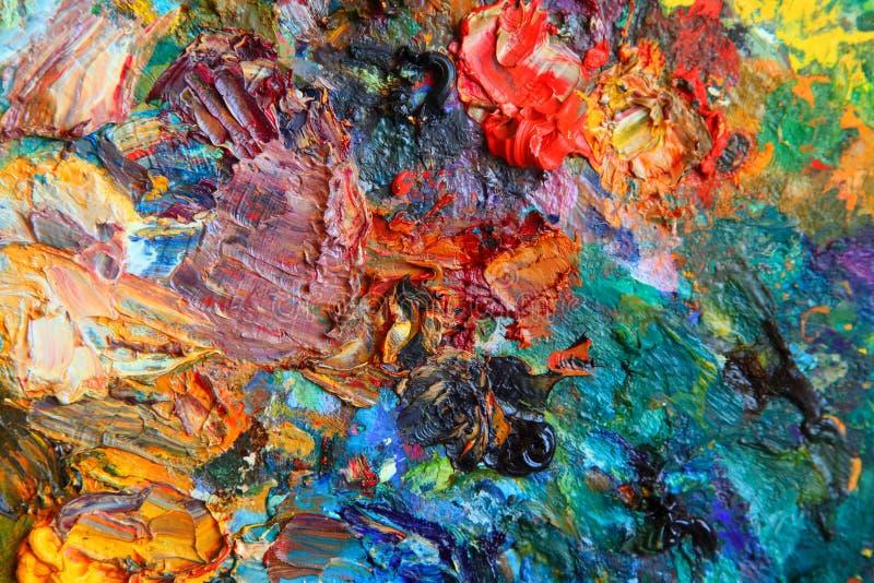 Immagine di sfondo della tavolozza luminosa della olio-pittura fotografie stock
