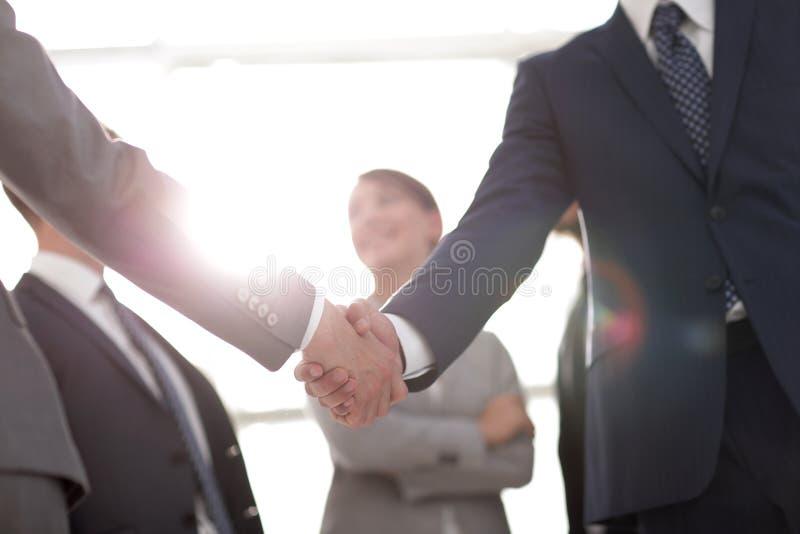 Immagine di sfondo della stretta di mano della gente di affari fotografia stock