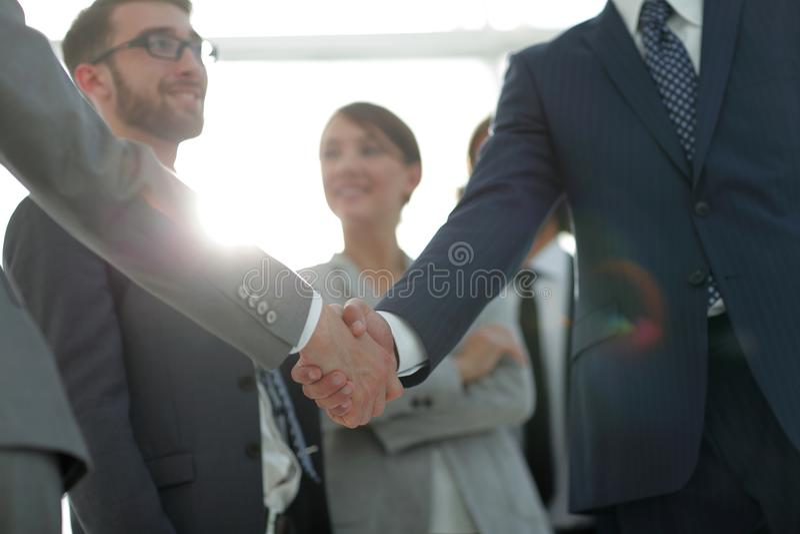 Immagine di sfondo della stretta di mano della gente di affari immagine stock libera da diritti