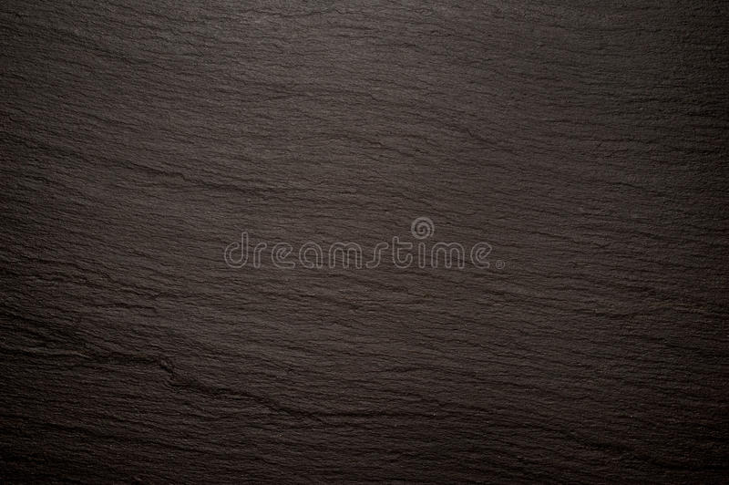 Immagine di sfondo nera di struttura dell'ardesia fotografie stock