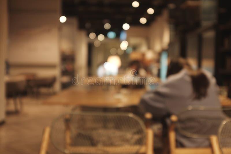 Immagine di sfondo vaga del gruppo di persone della sfuocatura della caffetteria fotografia stock libera da diritti