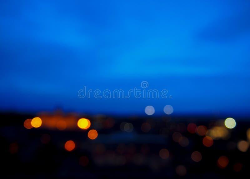 Immagine di sfuocatura delle luci della città immagini stock libere da diritti