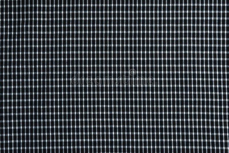 Immagine di tessuto a quadretti in bianco e nero per i precedenti e la creatività immagine stock