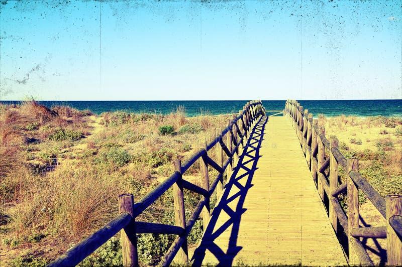 Immagine Grungy del ponticello della spiaggia immagine stock