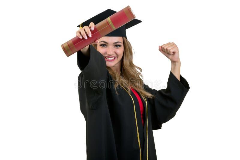 Immagine isolata completa dello studio da una giovane donna di graduazione immagini stock libere da diritti