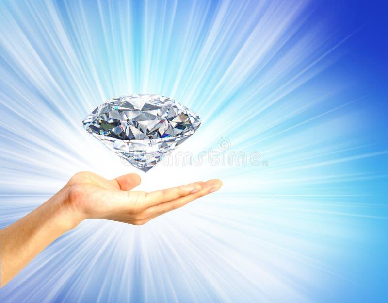 Immagine luminosa della mano con il grande diamante fotografie stock