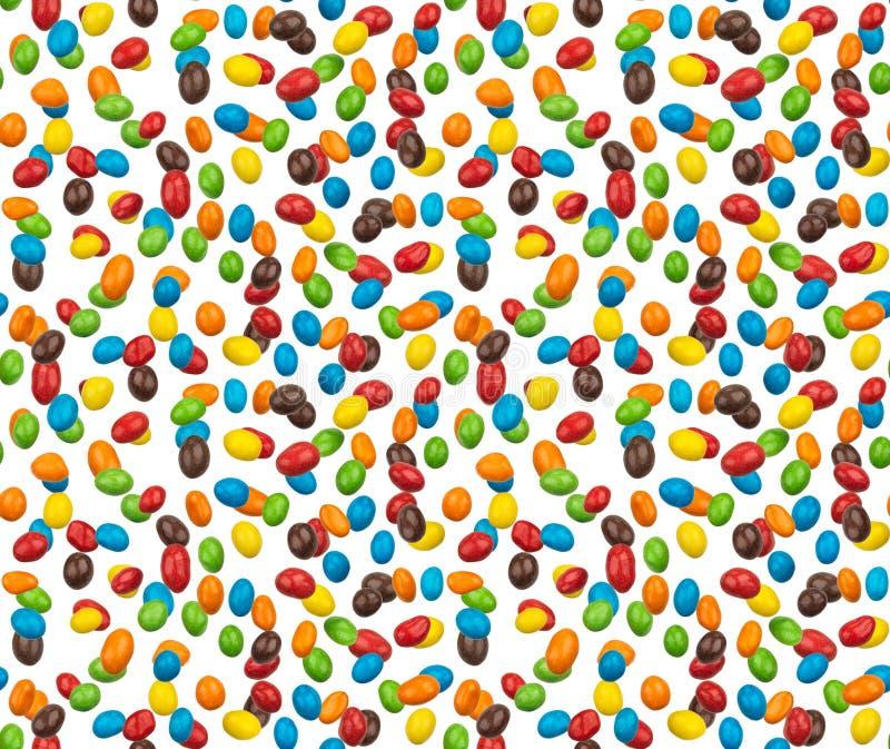 Immagine senza cuciture delle arachidi variopinte ricoperte di cioccolato fotografate immagini stock libere da diritti