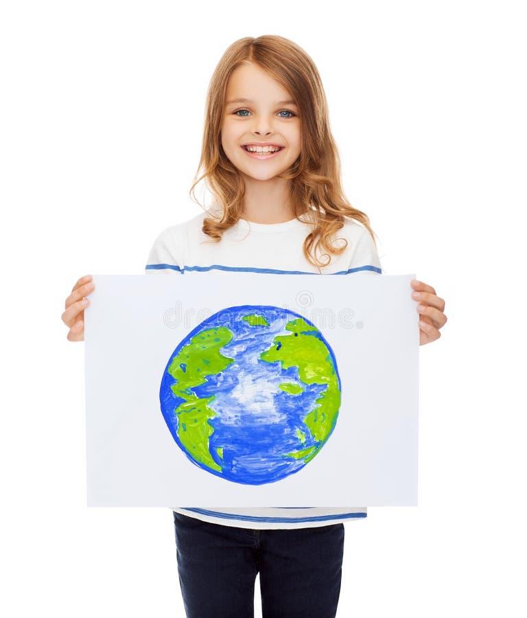 Immagine sorridente della tenuta del piccolo bambino del pianeta fotografia stock libera da diritti