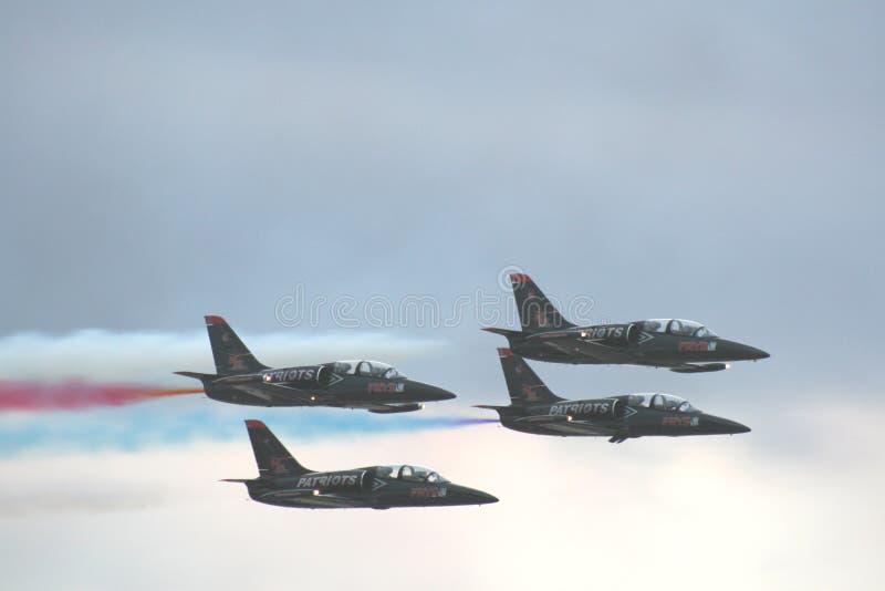 Immagine stupefacente degli aerei da caccia che volano al di sopra fotografia stock libera da diritti