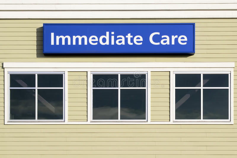 Immediate Care Sign Outside Hospital Building. Immediate Care Sign Above Windows Outside Hospital or Emergency Clinic Building royalty free stock images