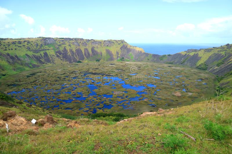 An Immense Crater Lake of Rano Kau View from Orongo Village on Easter Island with Pacific Ocean in the Distance, Chile. Beauty in Nature stock photography