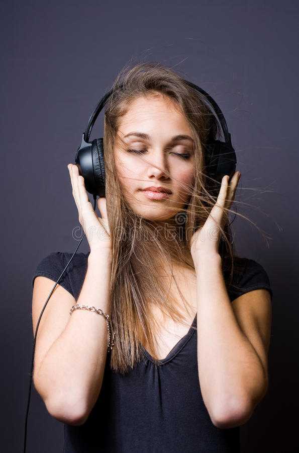 Download Immersed in music. stock image. Image of dark, audio - 23271113