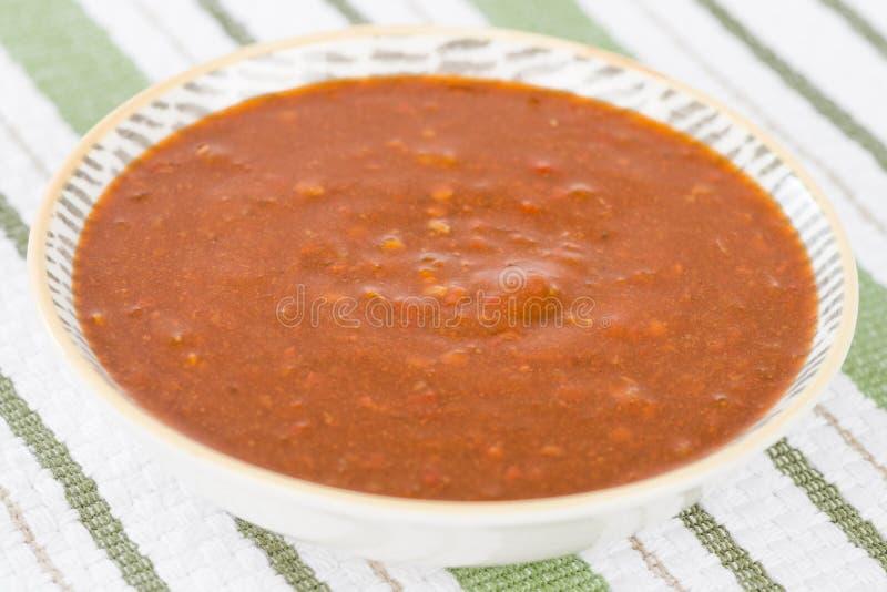 Immersione dei peperoncini rossi immagine stock