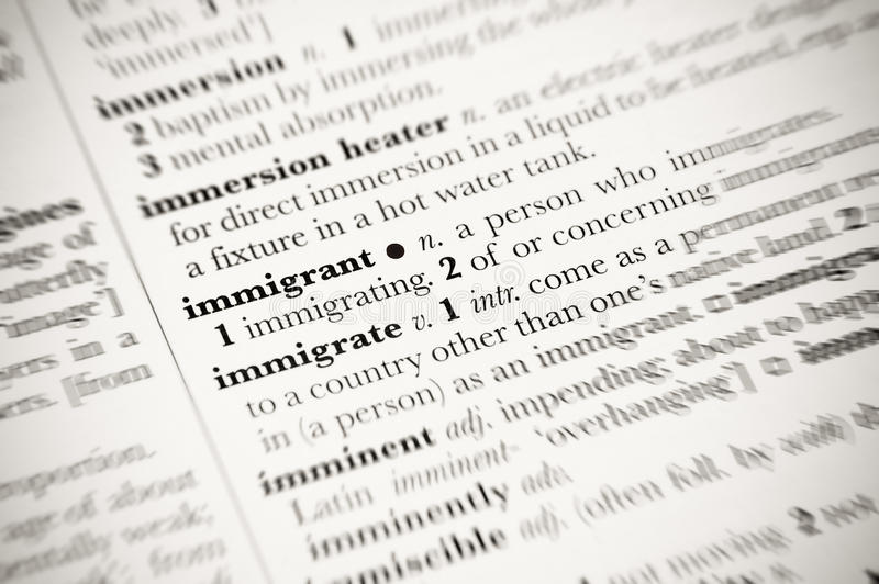 Immigrant. Dictionary definition of immigrant with blurred edges royalty free stock photography