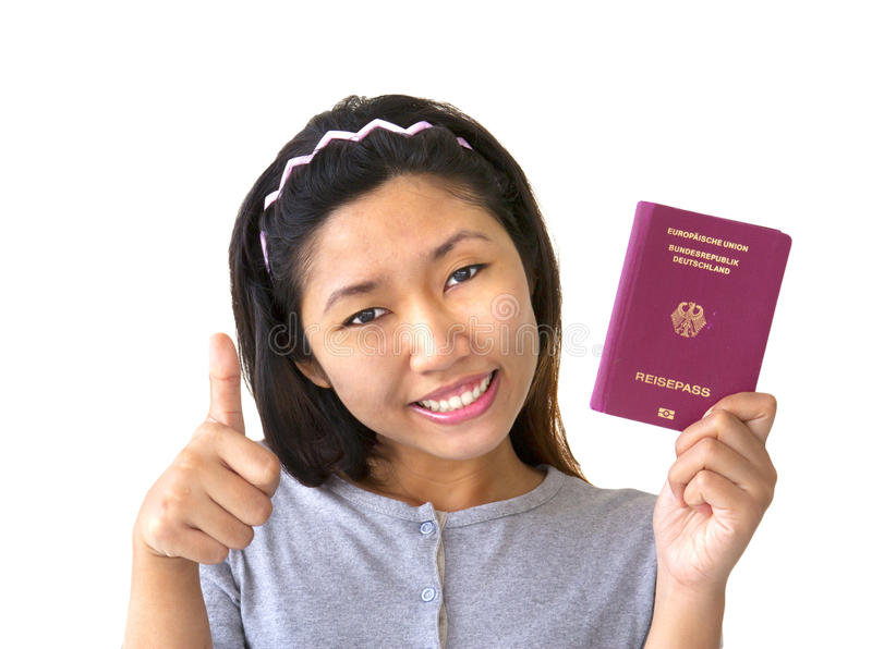 Immigrant woman holding German passport royalty free stock photo