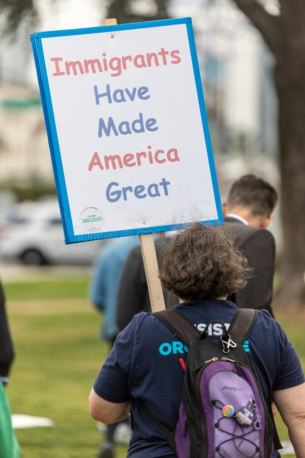 Immigrants Have Made America Great. BEVERLY HILLS, CALIFORNIA - MARCH 12, 2018: A protester holds a sign that reads, `Immigrants Have Made America Great` at the stock photography