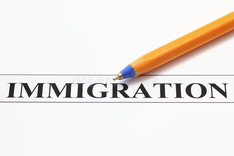 Immigration. Ballpoint pen and word Immigration stock images