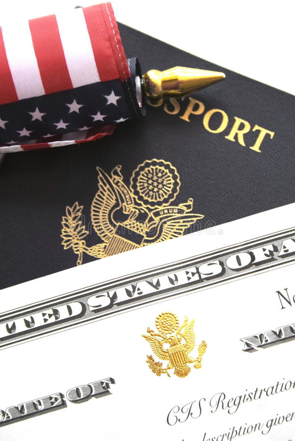 Immigration concept. US passport and flag over a citizenship and naturalization certificate stock photo