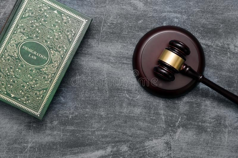 Immigration law book with judges gavel. Refugee citizenship law concept stock photography