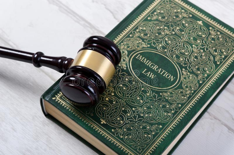Immigration law book with judges gavel. Refugee citizenship law concept royalty free stock photos