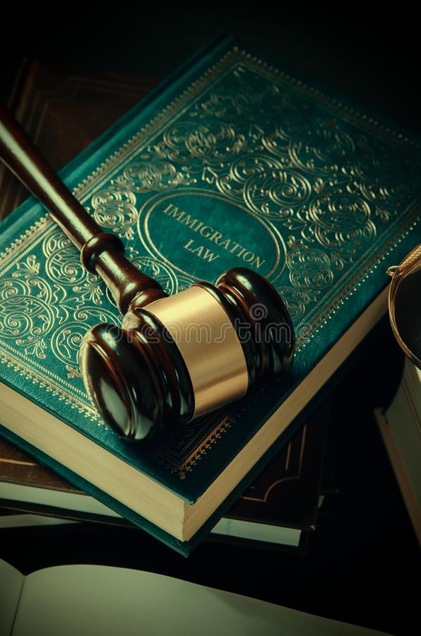 Immigration law book with judges gavel. Refugee citizenship law concept stock images