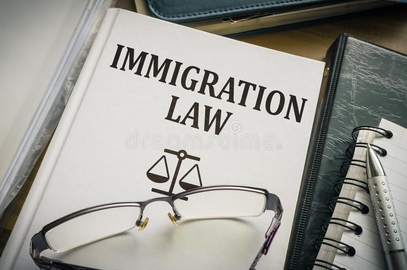 Immigration law book. Legislation and justice concept.  royalty free stock image