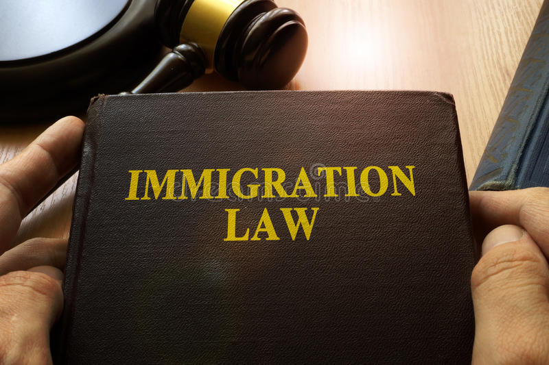 Immigration law. Immigration law on an office table stock photos