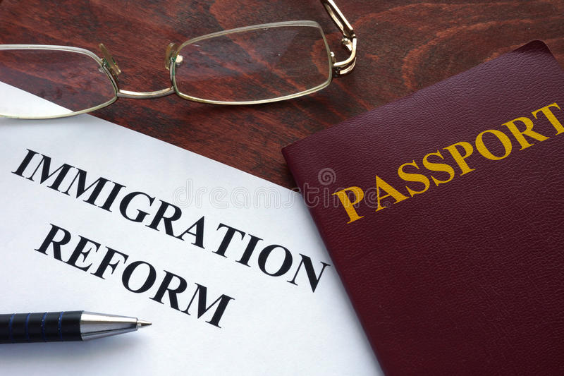 Immigration reform. Paper with immigration reform on a table stock images