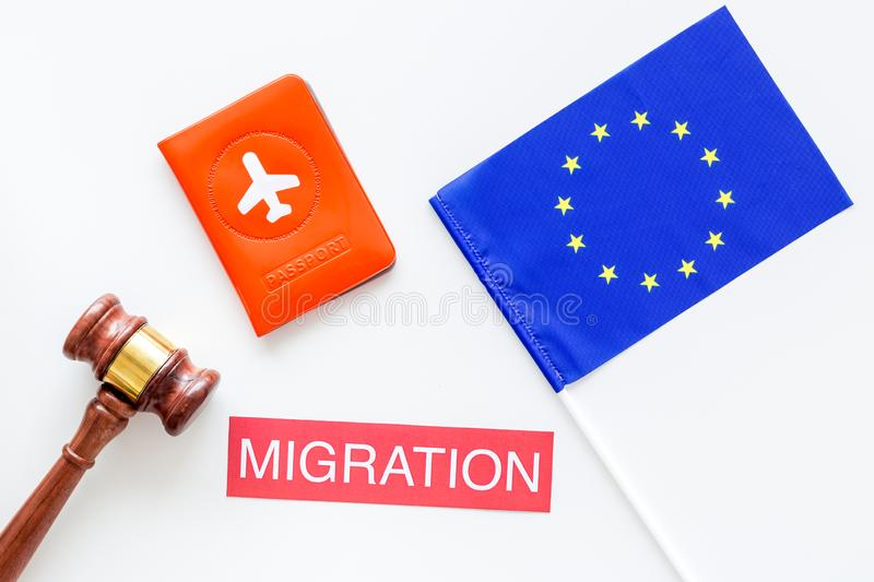 Schengen visa. Immigration to Europe concept. Text immigration near passport cover and european flag, hammer on white royalty free stock images