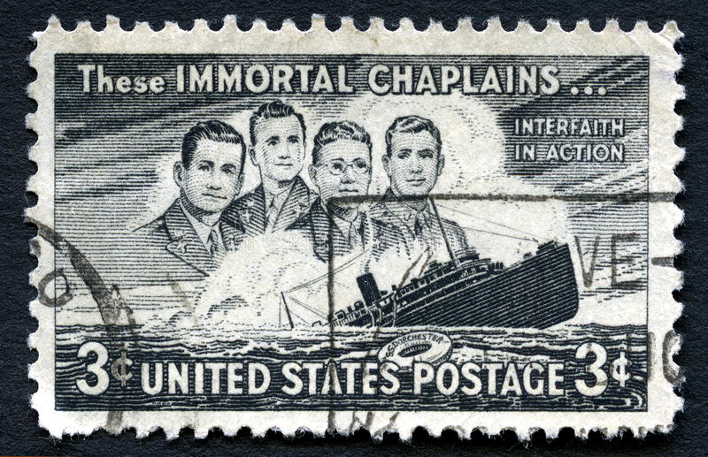 These Immortal Chaplains US Postage Stamp. UNITED STATES OF AMERICA - CIRCA 1948: A used postage stamp from the USA issued on the 5th Anniversary of the sinking stock image