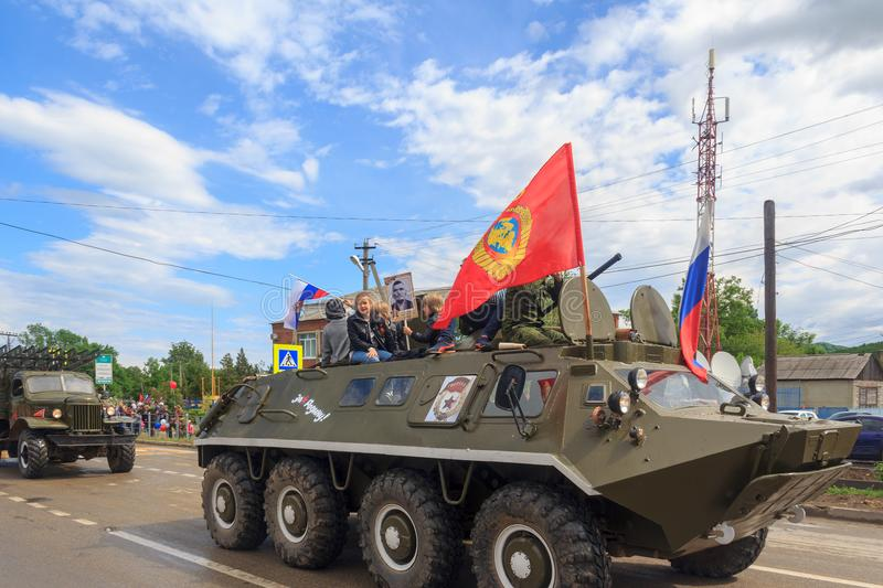 Immortal regiment, Parade on victory day with the participation of schoolchildren and military equipment stock images