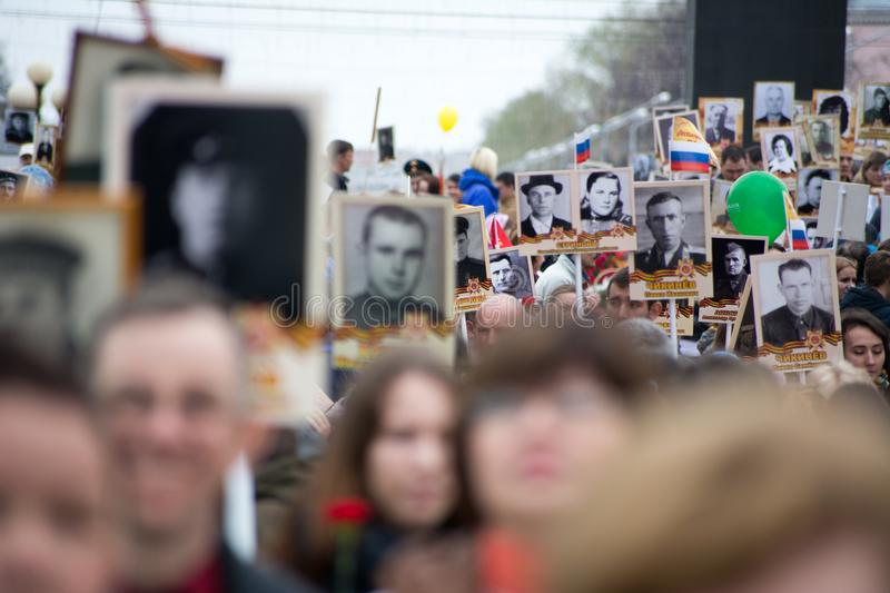 Immortal Regiment - people with portraits. Yoshkar-Ola, Russia - May 9, 2017 Immortal Regiment - people with portraits of their relatives, participants in the royalty free stock photo