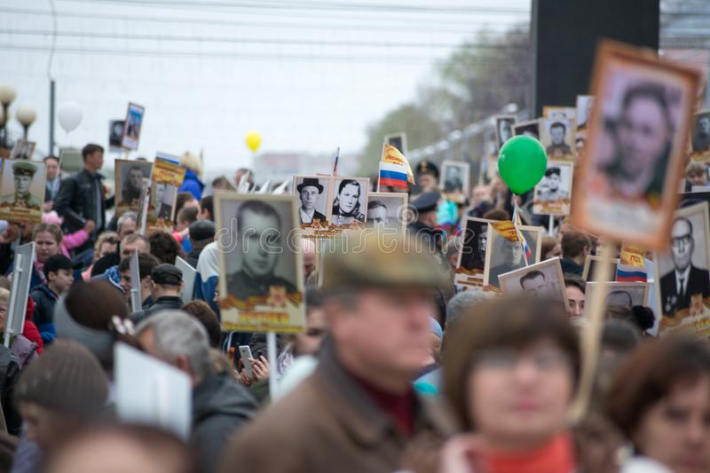 Immortal Regiment - people with portraits. Yoshkar-Ola, Russia - May 9, 2017 Immortal Regiment - people with portraits of their relatives, participants in the stock photos