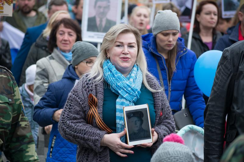 Immortal Regiment - people with portraits. Yoshkar-Ola, Russia - May 9, 2017 Immortal Regiment - people with portraits of their relatives, participants in the royalty free stock photography