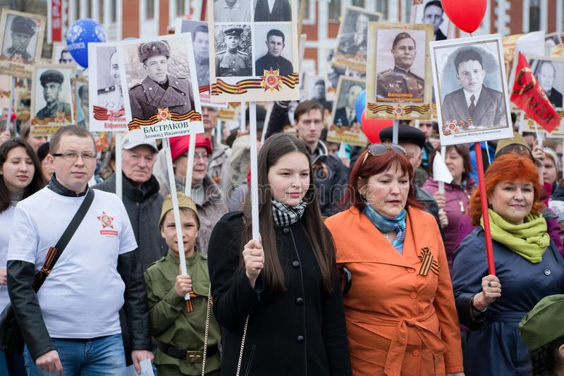 Immortal Regiment - people with portraits. Yoshkar-Ola, Russia - May 9, 2017 Immortal Regiment - people with portraits of their relatives, participants in the stock photography